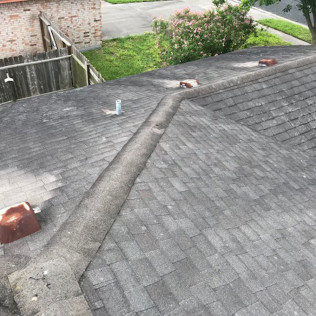 Worn roof before a roof replacement